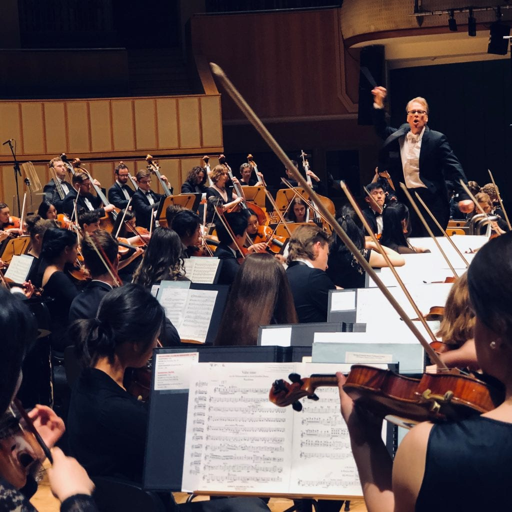 Richard Davis takes the orchestra through its paces at the Singapore dress rehearsal. By Paul Dalgarno.