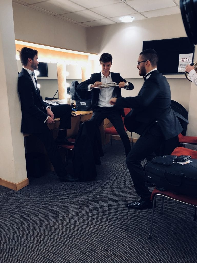 L-R: Connor Jenkinson (trumpet), Joel Walmsley (trumpet) , Alex Jeantou (tuba) limber up ahead of the Singapore concert. By Paul Dalgarno.