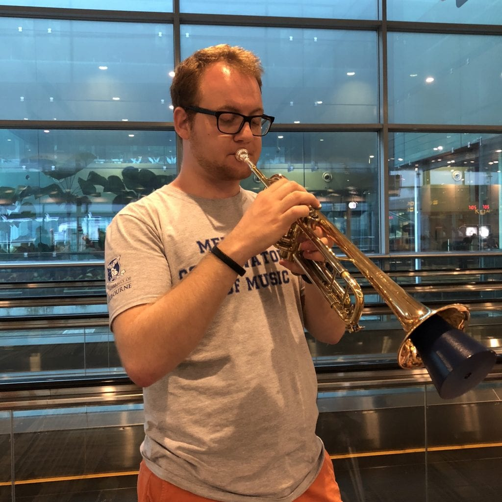 Mads Sørensen gets in some trumpet practice at Singapore's Changi Airport. By Paul Dalgarno.