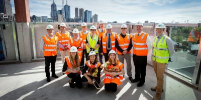 L-R back row: Architect John Wardle,Victorian College of the Arts Director Professor Jon Cattapan, Faculty of Fine Arts and Music Executive Director Jane Richards, Melbourne Conservatorium of Music Director Professor Gary McPherson, JWA architect Meaghan Dwyer, Chair of The Myer Foundation Martyn Myer, University of Melbourne Vice-Chancellor Professor Duncan Maskell, Dean of the Faculty of Fine Arts and Music Professor Barry Conyngham, Victoria's Minister for Creative Industries Martin Foley, Lendlease Construction Manager Nat Gray, with (L-R) front row: Melbourne Conservatorium brass students Hannah Rundell, Kiran Samuel and Natalia Edwards on the roof of The Ian Potter Southbank Centre. By Sav Schulman.