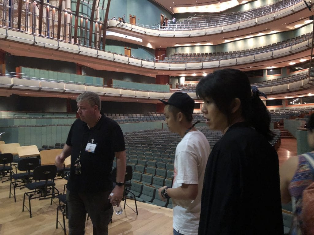 Paul Doyle (left) and Mandy Lo (right) discuss the stage set-up with Esplanade Concert Hall staff. By Paul Dalgarno.