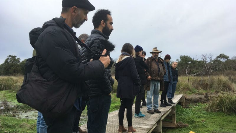 Arts and Community Practice, Master of Contemporary Arts and Wilin students receiving a tour of the Budj Bim Cultural Landscape from Associate Professor Richard Frankland. Photo by Danny Butt .