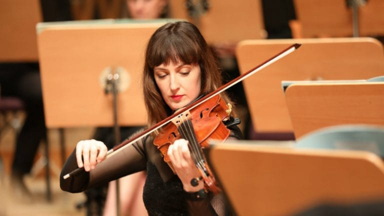 Violist Cecilia Dowling in rehearsal at the Shanghai Symphony Hall. By Lori Wu.