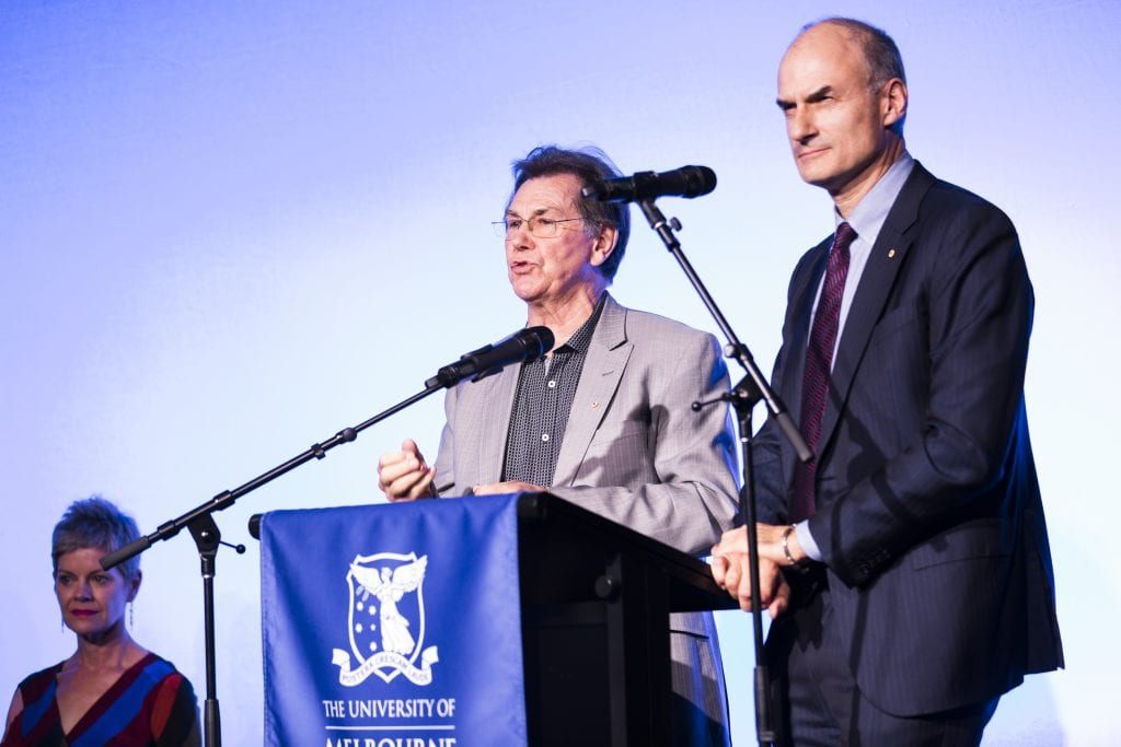Professor Barry Conyngham, Dean of the Faculty of Fine Arts and Music, shares a lectern with Martyn Myer at the opening of The Stables on 14 May 2018. By Drew Echberg.