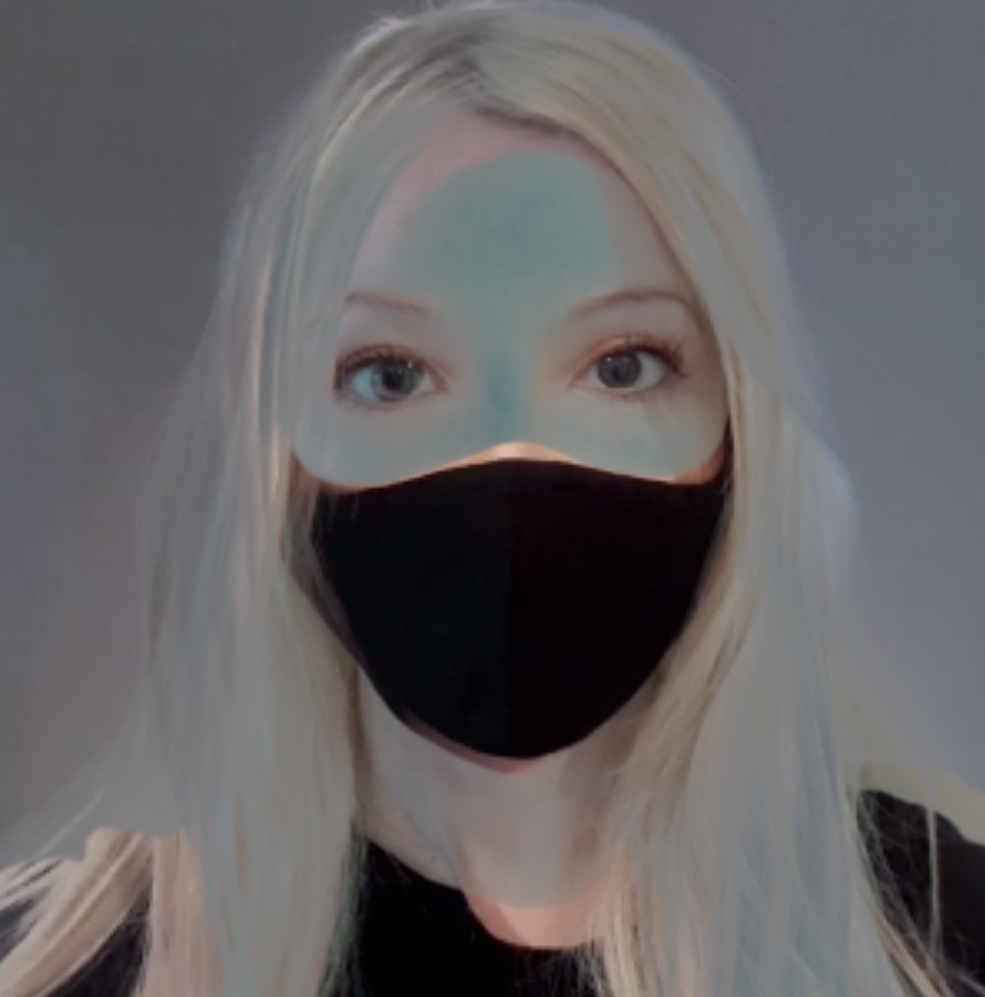 Performance image of a masked person with blonde hair