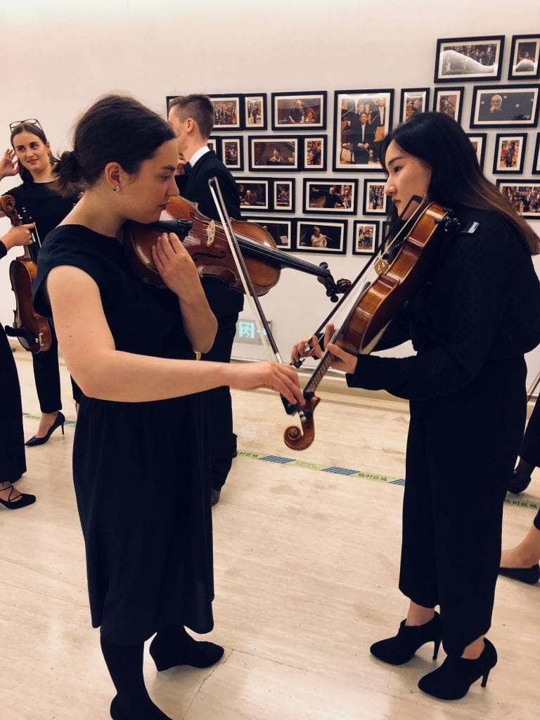 L-R: Violists Alexandra Orr and Young-jin (Katie) Ko backstage in Shanghai. By Paul Dalgarno.