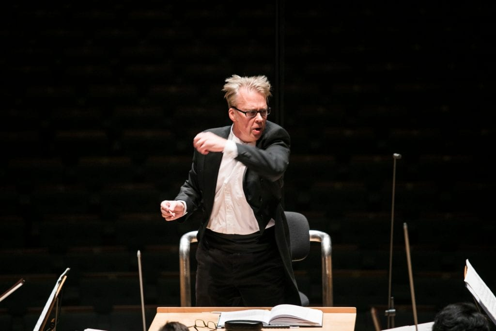 Conductor Richard Davis at the rostrum in Singapore. By Lori Wu.