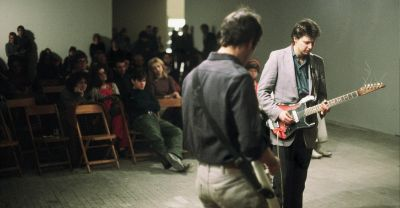 Glenn Branca performing at Hallwalls in the 1980s. Image courtesy of Hallwalls' archive. Wikimedia Commons.