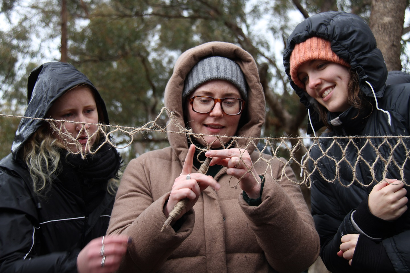 Students work together to weave a fishing net. Photo by Mireille Stahle.