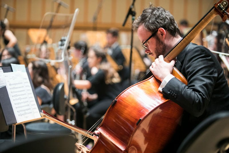 Double bassist Ian Crossfield onstage at the Singapore Esplanade Concert Hall. By Chris P Lim.