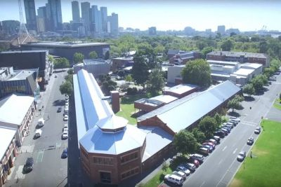 The Stables in the foreground of the Melbourne Arts Precinct. Video still from Bison United, 2018.