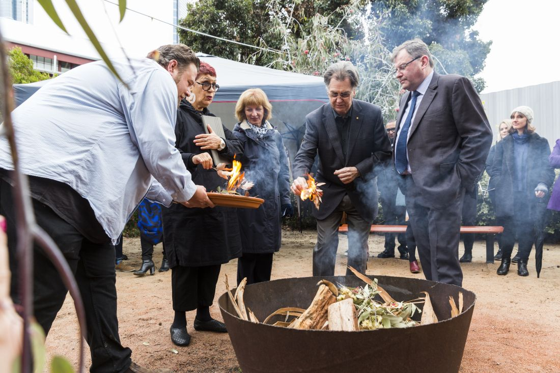 Barry Conyngham with, left to right, Head of the Wilin Centre Tiriki Onus, N'arweet Carolyn Briggs, Dr Sarah Maskell and University of Melbourne Vice-Chancellor Duncan Maskell, at the annual Lighting of the Wilin on the Southbank Campus, 2019. By Sav Schulman.