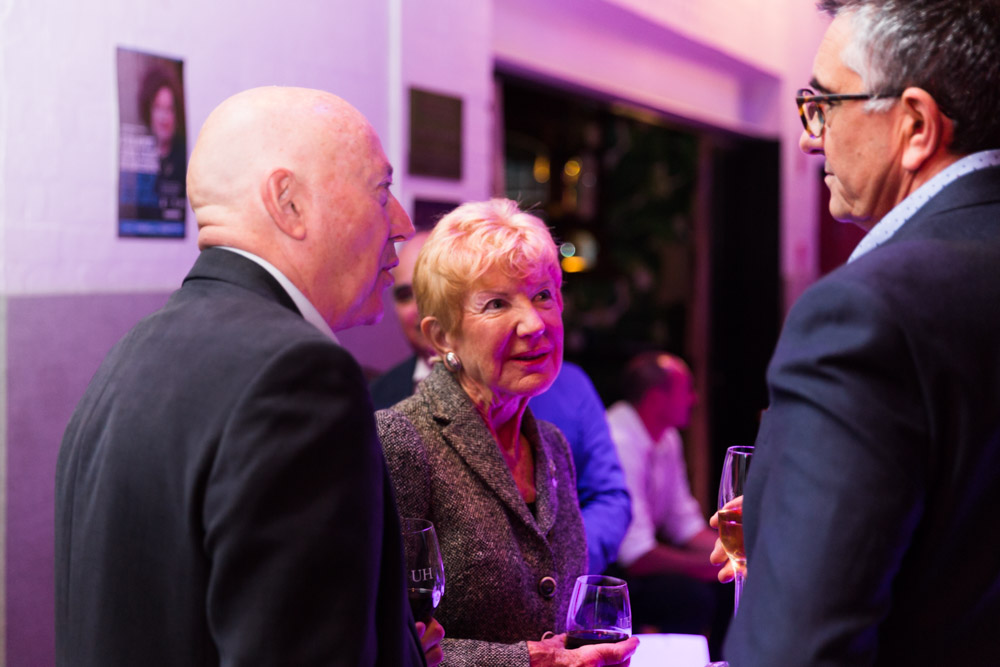 Ron and Margaret Dobell in discussion with VCA Director Professor Jon Cattapan (right of image) at the VCA's 2017 Music Theatre fundraiser. By Drew Echberg.