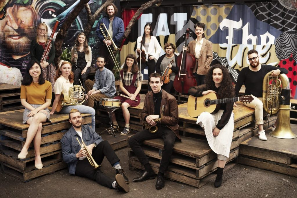 Melbourne Conservatorium students at Section 8, Melbourne. Front row, l-r: Sze Min Ng, Reuben Lewis, Keidan Morley, Rose Gonzalez, Alexander Jeantou. Second row, l–r: Natalia Edwards, Oliver Iacono, Alexandra Czarnecki-Roper. Third row, l–r: Emma Morrison, Brienne Gawler, Amy You, Rachael Richardson, Chiara Anderson. Back row: David Farrell. Image by John O'Rourke.