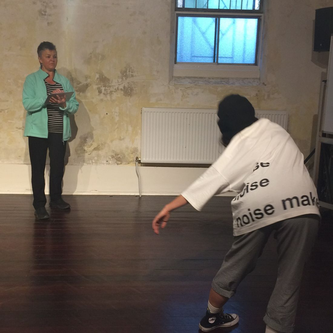 Dr Kim Dunphy using MARA to assess a client's progress in a dance movement therapy session. Image supplied.