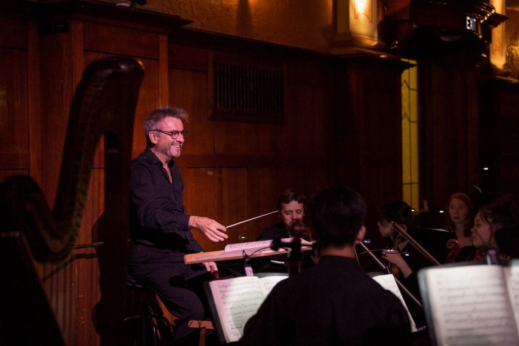 Paul Kildea conducts Melbourne Conservatorium staff and students during Albert Herring, 2019. By Ben Fon