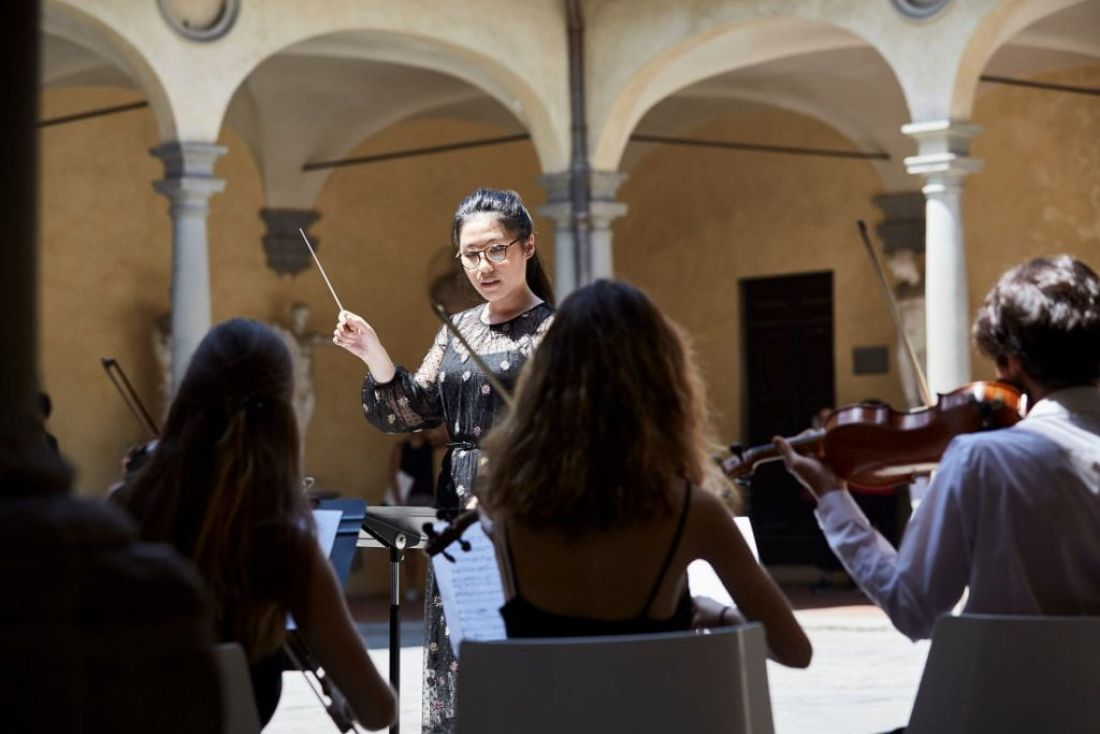 "Danna Yun conducts her work ""Riddle for String Ensemble"" at the Accademia Di Belle Arti Di Firenze. By O'Rourke & Gates."