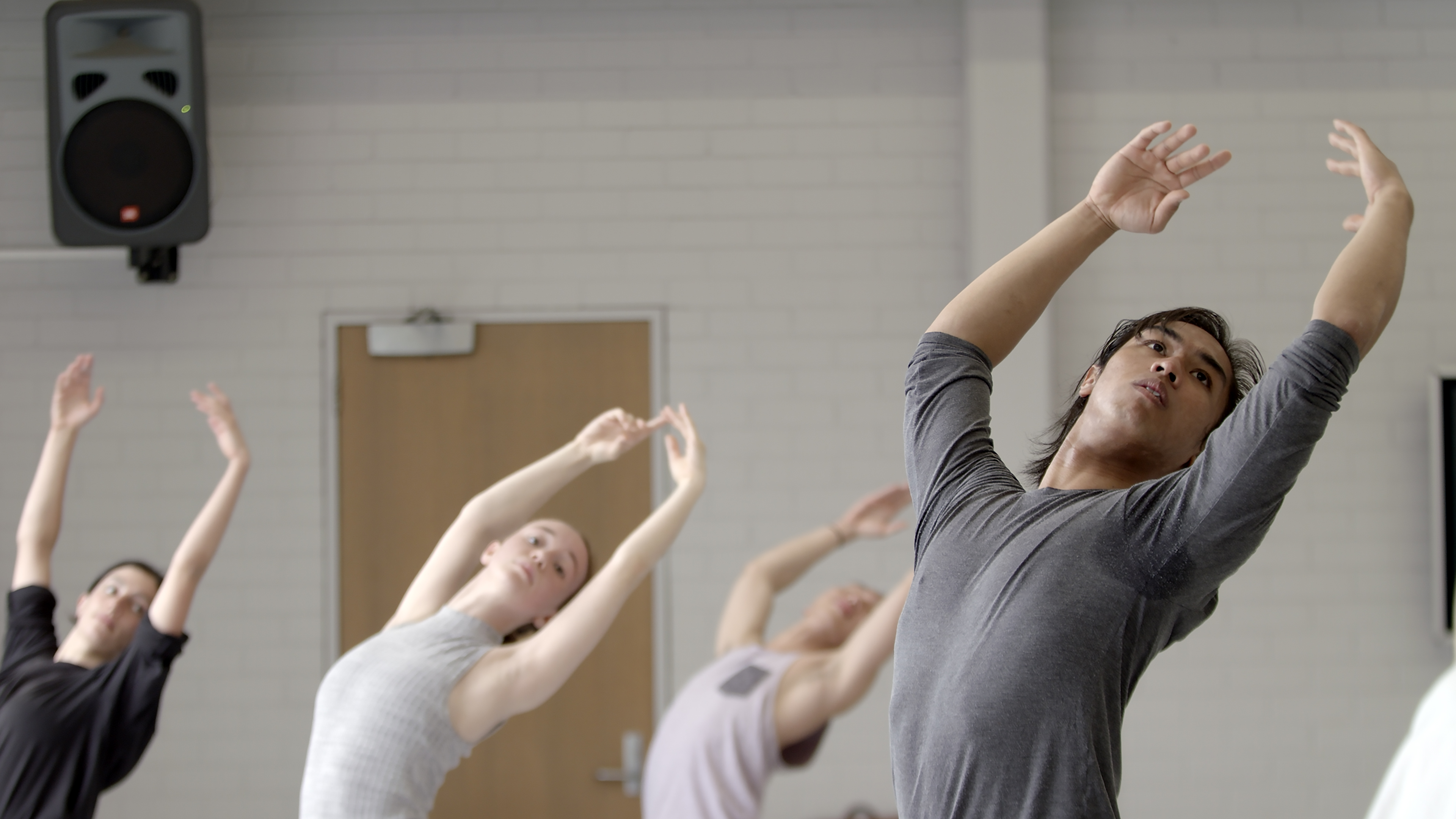 Bachelor of Fine Arts (Dance) student Kyle Ramboyong rehearses in a ballet class with peers at the Victorian College of the Arts.