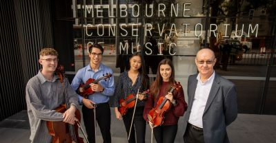 The Conservatorium's Kalon Quartet (Aidan Filshie, Oscar Woinarski, Amy You, and Louise May) with Conservatorium Director Professor Gary McPherson outside The Ian Potter Southbank Centre. By Sav Schulman.